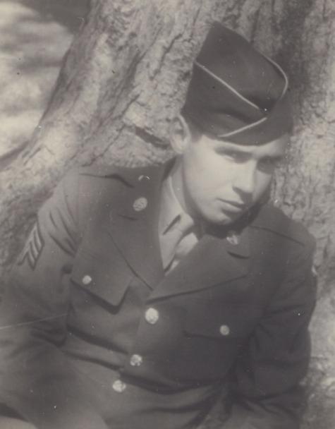 Peter Schmitt in uniform against tree